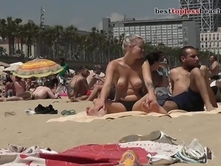 Sexy busty girl Topless on the Beach