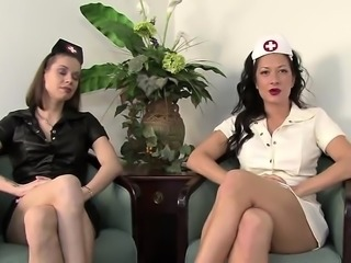 Masked guy has two sexy nurses taking care of his ballbusti