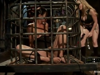 Who would know, that ordinary joke will end so roughly. Now, totally naked Dana, sits in a metal cage with electro plug in her asshole. Wrathful Aiden, from time to time touches her caged slave with electric wand, giving her some refreshing electric power. I swear, Dana had already got some strong orgasms. Enjoy!