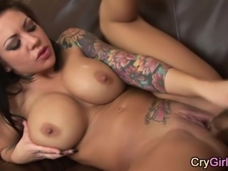 tough looking tattoo girl crying after intense orgasm