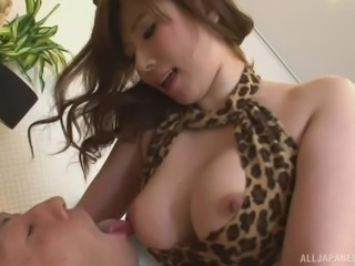 This hot japanese babe is dressed up in a revealing leopard bikini and ears....