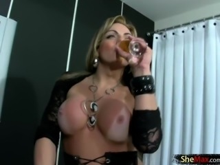 Doll with balls in black lace spreads her ass cheeks wide
