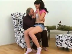 Old dude stuffs mouth of a young hottie with his nasty rod