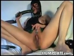 Kinky babe with piercings inserts cucumber in her ass and cunt