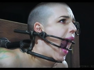 I can not even imagine how Abigail could stand it. Her black tormentor placed her in a special device, with all body parts fixed tough. He roughly fucked her with a dildo, clamped her nipples and stimulated her with a candle fire. Extreme original device bondage with lots of painful humiliation! Rough!