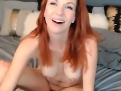 Pretty young woman with reddish dyed hair performs with her