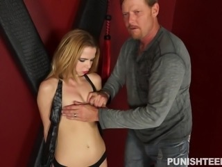 Alina West was tied up in a dungeon and she had no idea, what her master is planning. He tied her to a wooden post and started whipping her. He ball gagged her mouth, to suppress her moans. At last, she offered blowjob to satisfy her master. He was happy with her performance and released her.