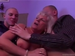 Granny was lying nude in room, so me and my friend decided to fuck her. I...