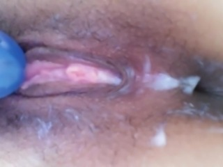 Up close view of pussy being made to cream plus small squirt