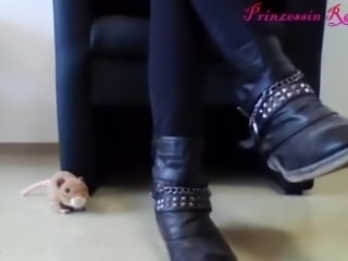 Extremely pretty blonde goddess removes her boots to show her white socks