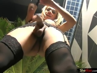 Blonde tranny in hot string bikini strokes her monstercock