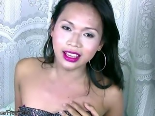 Asian tranny fondles her balls cameltoe and jerks tiny cock
