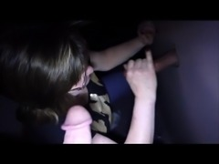Wife blows a guy through the glory hole while hubby watches