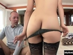 While her much older step dad sits on the couch, the...