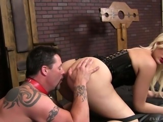 Blonde haired mistress Jenna Ivory in tight black corset shows