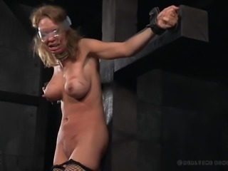 Rain DeGrey needs to be punished, as she is lazy and disobeys boss orders. Two masters were hired to teach her a lesson and they did their job superbly. She was undressed and weights were hanged from her nipples. A vibrator is placed on her clit and she experienced pain and pleasure simultaneously.