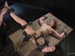 slave is locked in a bondage device