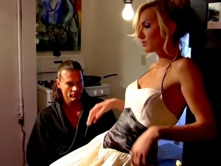 Blonde beauty rides stud's dick in the kitchen
