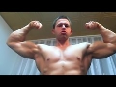 Bodybuilder up close flexing
