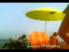 Hidden camera at a nudist beach captures a sexy young starl