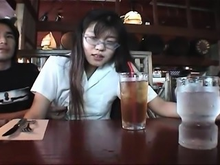 Horny petite Asian enjoys a gag ball in her mouth and a har
