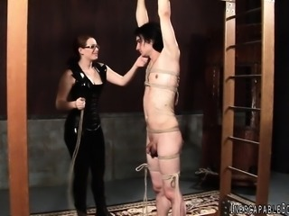 Sexy redhead is a hot dominatrix who loves to tie a guy down