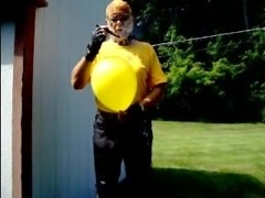 LeatherBiker bitch popping a yellow balloon with her cigar