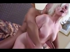 Blonde granny fucks young man in hotel