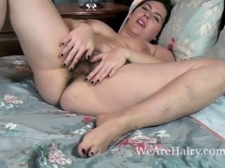 Sharlyn is quite sexy. Shes takes off her dress, stockings, and panties and...