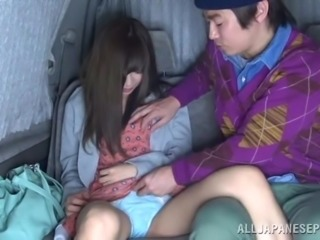Japanese girl gets fingered in a car in front of another girl