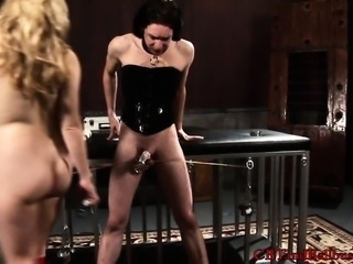 Busty blonde mistress clamps her corseted slave's cock and balls in hardcore BDSM