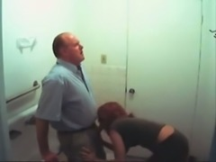 Redhead secretary sucking boss's dick in a toilet
