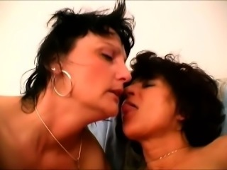 Mature lesbians mack out and finger, toy, and lick some wet snatch