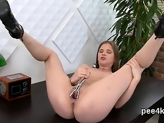 Luscious nympho is pissing and fingering bald vulva