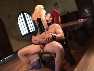 Hottie in a tight black latex corset and her man boning hardcore