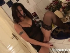 Sex-insane whore wearing stockings and corset fucks herself in the public toilet