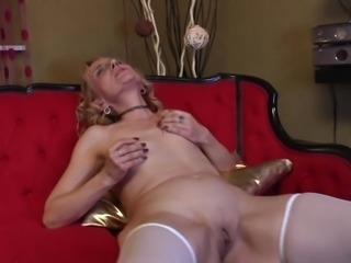Sexy granny in a lingerie set gets naughty with her pussy