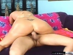 Striking babe oils up her sublime ass and takes a big cock for a ride