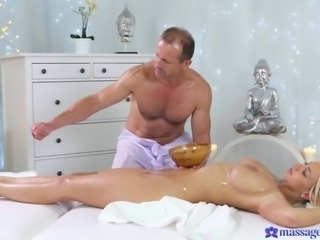 Nathaly is one of the customers, who pays by having sex. She lays down and lets masseur to play with her private parts. He oils her boobs, squeezes them hard and rubs oil on her pussy, pushing his oily fingers deep inside. He licks her cunt, then fucks her in missionary.