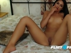 Eva Oxton Pleases Her Tight Pussy With Her Black Dildo