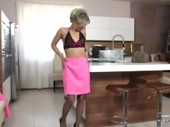 Mature hottie strips after work to toy her wet pussy