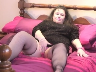 BBW in pink lingerie and fishnets fondles her huge tits