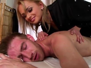 Ravishing blonde babe gives a massage then takes a big cock up her asshole