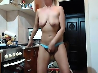 Sexy blonde loses her clothes and displays her curves in th