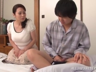 A hungry Japanese mature woman is waiting for a dick