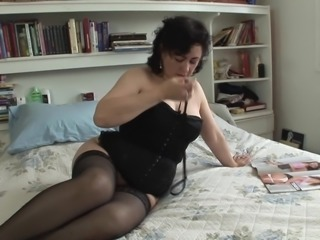 Big mature breasts come out of her sexy black corset
