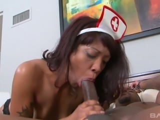Naughty nurse in sexy uniform Lotus Lain is fucked by horny black patient