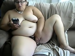 Chunky amateur babe with glasses exposes her hairy pussy on