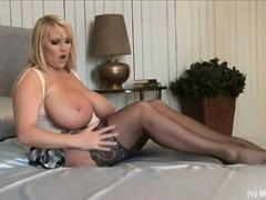 Huge breasted blonde beauty in stockings Laura gently fingers her cunt