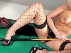 Blonde masturbates in fishnet stockings